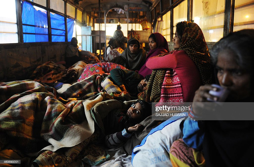 IndiasocialhealthhospitalFOCUS In this photograph taken on January 8 Indian cancer patient Sudeep Kumar lies alongside family members and others...