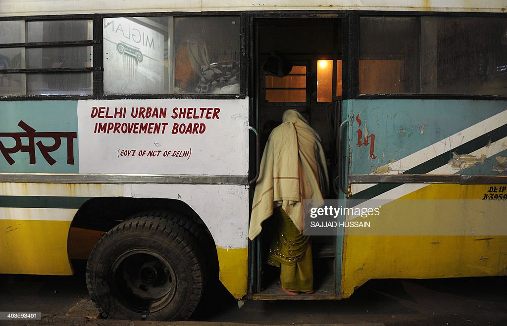IndiasocialhealthhospitalFOCUS In this photograph taken on January 8 an Indian resident enters an abandoned bus used as a makeshift night shelter...