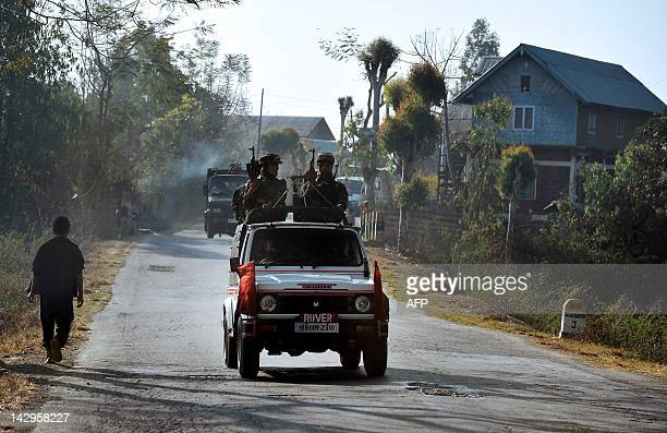 IndiaunrestManipurpoliticsFEATURE by Abhaya Srivastava A vehicle carrying armed security personnel passes along a road on the outskirts of Imphal in...