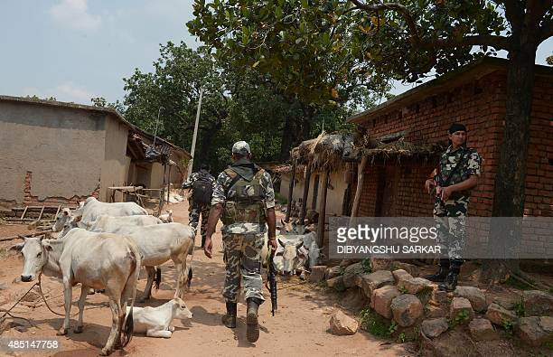 IndiaunrestMaoistFEATURE by Abhaya Srivastava In this photo taken on August 7 Indian Central Reserve Police Force personnel patrol through a village...