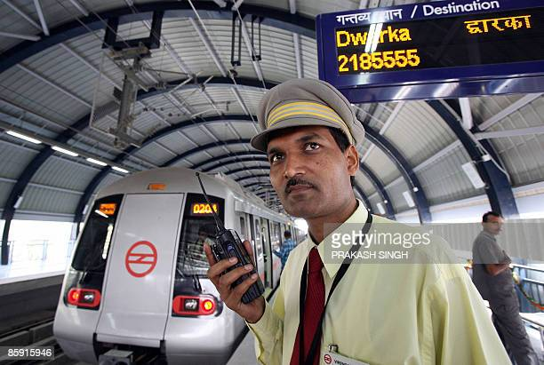 IndiavotefinanceeconomyFOCUS BY PENNY MACRAE In this picture taken November 11 Indraprastha station's chief safety officer Virendra Singh talks over...