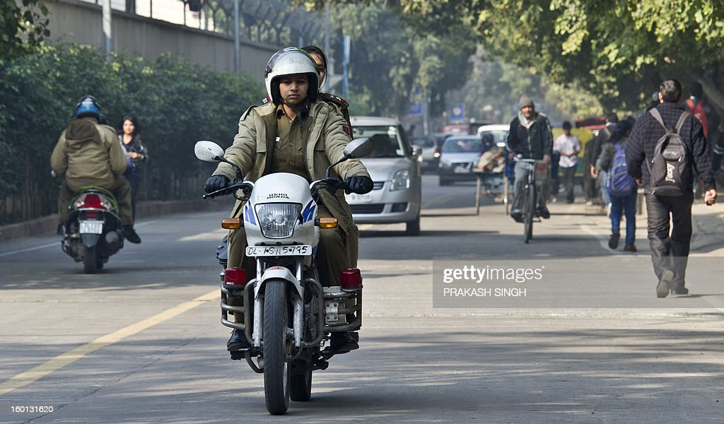 India-women-crime-police,FEATURE by Ammu Kannampilly This picture taken on January 22, 2013, shows women police officers patrolling at Delhi University north campus in New Delhi. A government plan to improve policing following criticism after the recent gruesome gang-rape and murder of a student on a moving bus in New Delhi also includes measures to recruit more women. Females make up just 6.5 percent of the country's force, according to figures in the National Crime Records Bureau. AFP PHOTO/ Prakash SINGH
