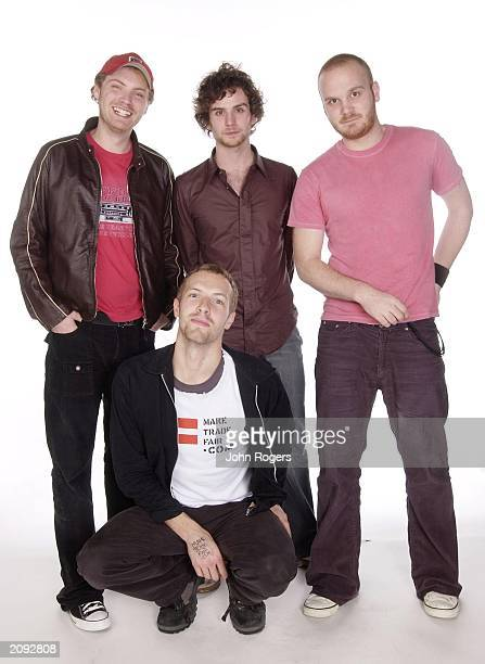 Indie rockers Coldplay lead guitarist Jon Buckland bassist Guy Berryman drummer Will Champion and lead singer Chris Martin pose for studio shots at...