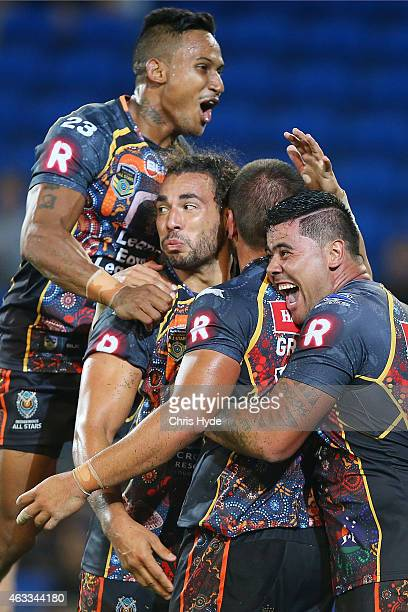 Indigenous All Stars celebrate a try during the NRL preseason match between the Indigenous All Stars and the NRL All Stars at Cbus Super Stadium on...