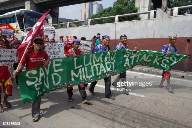 Indigenous and nonindigenous activists hold a rally coinciding the International Day of the World's Indigenous Peoples outside Camp Aguinaldo in...