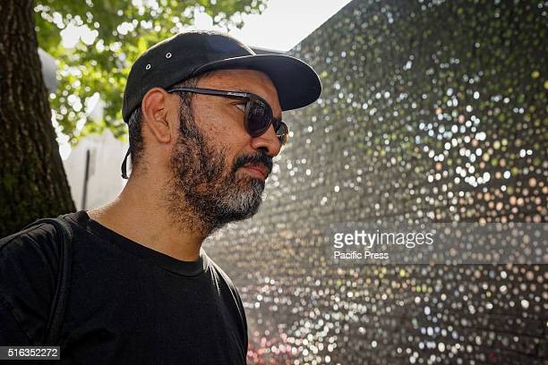 ISLAND SYDNEY NSW AUSTRALIA Indigenous artist Daniel Boyd is pictured with his artwork Redfern Wall during the media preview for Biennale of Sydney...