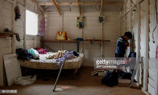 A indigenous child from a Guarani tribe uses a cell phone in his hut in the Pico de Jaragua national reserve in Sao Paulo Brazil on August 31 2017 A...