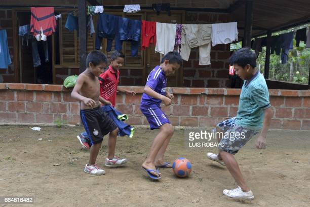 Indigenous children play soccer in Mocoa Putumayo department Colombia on April 4 2017 Meanwhile looting has become a problem in some areas Local...