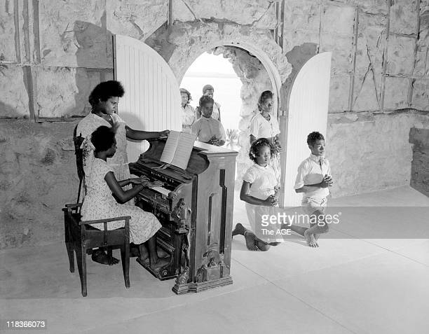 Indigenous children pray in the church of St Joseph's Catholic Mission on Hammond Island in the Torres Strait Queensland