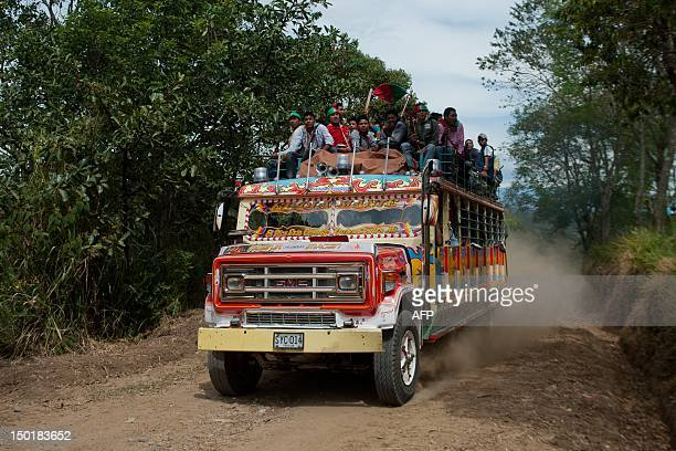 Indigenous Colombians arrive on top of a bus on August 11 at La Maria indigenous reservation municipality of Piendamo Cauca department Colombia...