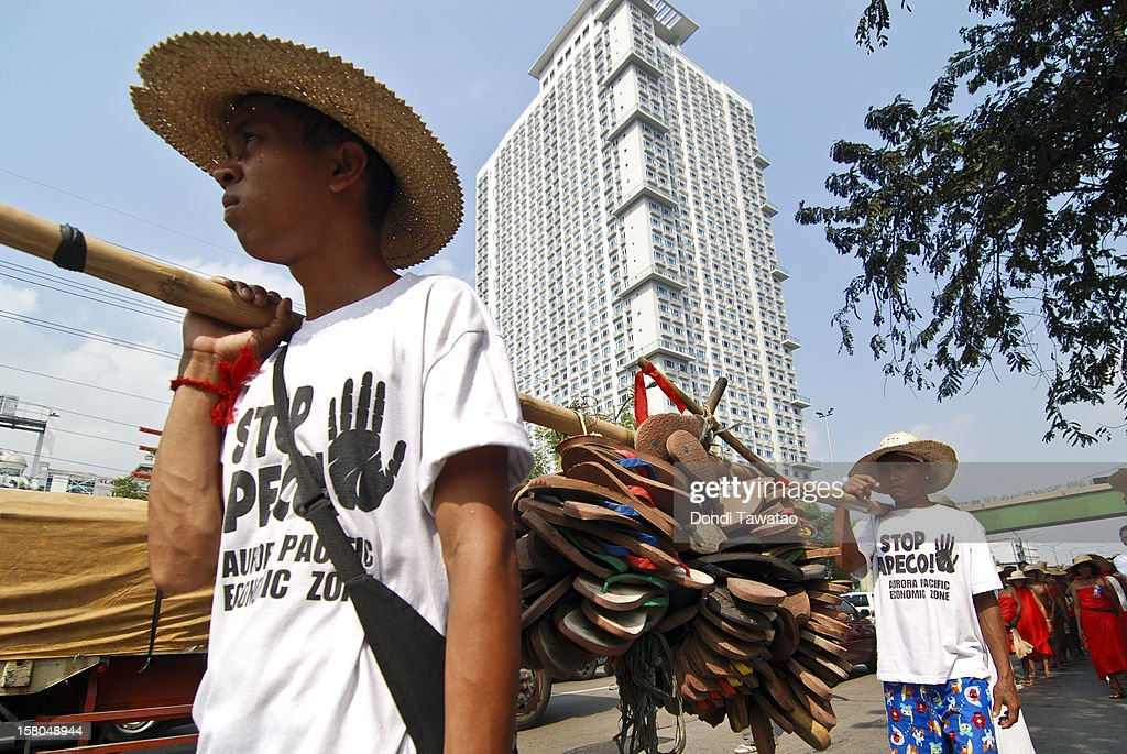 Indigenous farmers and fishermen attend a protest march in Katipunan on December 10, 2012 in Manila, Philippines. An indigenous group of Dumagat tribes, farmers and fisherfolk are traveling 350 kilometers by foot from the northern region of Casiguran, Aurora to the capital city of Manila in an effort to stop the construction of an export processing zone called APECO, or the Aurora Pacific Ecozone and Freeport Authority. The farmers say the project has already displaced 3,000 families in the area and will remove their sources of livelihood and disrupt their lives. A total of 12,000 hectares of farm and coastal lands has been appropriated for the project.