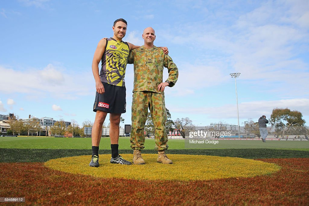 Indigenous footballer Shane Edwards poses with Sergeant Dan Colquhoun who will play in a curtain raiser match before tomorrow nights Indigenous Round match between the Tigers and Bombers during a Richmond Tigers AFL training session at ME Bank Centre on May 27, 2016 in Melbourne, Australia. The AFL celebrates Indigenous Round this weekend.