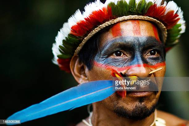 Indigenous from several tribes participate in the Sacred Fire Lighting Ceremony at the KariOca village during the United Nations Conference on...