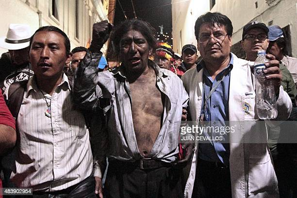 Indigenous leader Salvador Quishpe gestures after clashing with the riot police in Quito on August 13 during a strike organized by opposition...