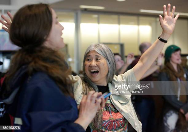 Indigenous leaders and climate activists disrupt business at a Chase Bank branch to protest funding tar sands development and projects like the...