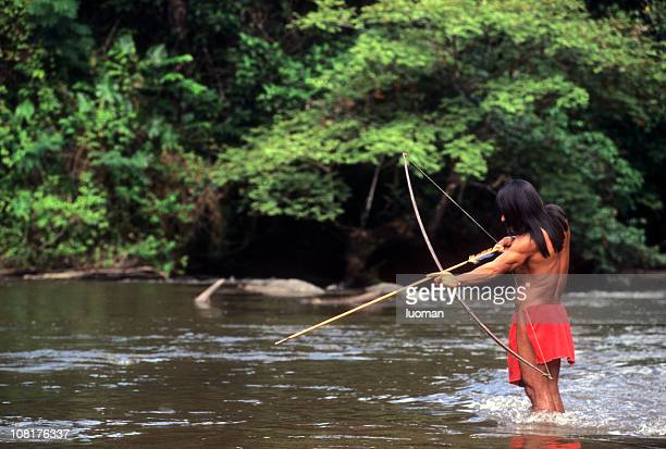 Indigenous Man Hunting in Amazon