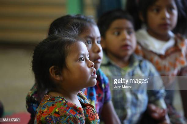 Indigenous Mayan Mamspeaking children listen during a reading circle at the Grupo Cajola library on February 12 2017 in Cajola in the western...