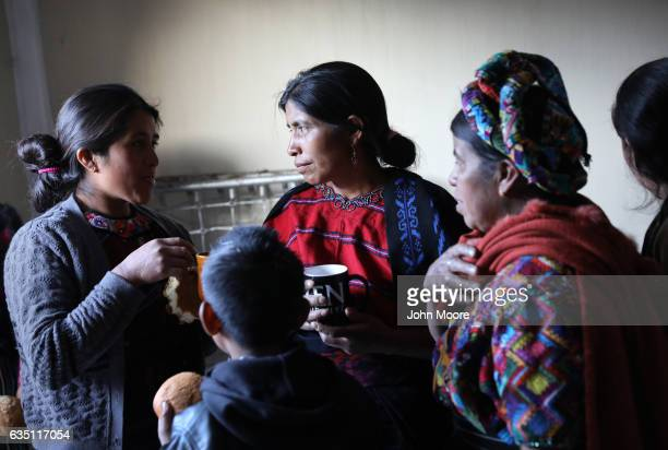 Indigenous Mayan Mamspeaking women drink coffee after a group meeting on February 12 2017 in Cajola Guatemala Women are especially effected by...