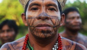 Indigenous men look on during a ceremony honoring the Xingu River before the start of the Xingu 23 event that gathers resisters of the Belo Monte dam...