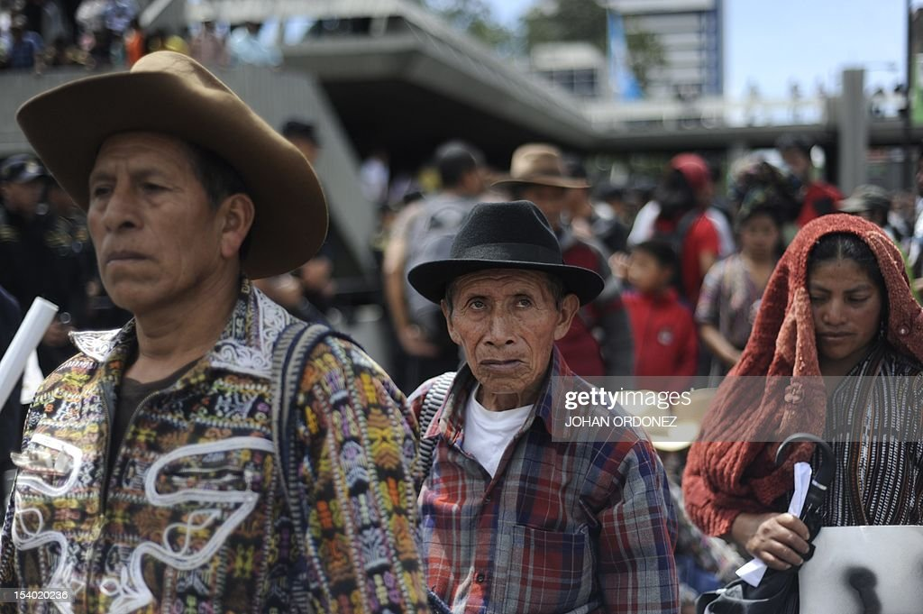 Indigenous people take part in a protest in Guatemala City on October 12 2012 The protest took place as a reaction to the eight indigenous...