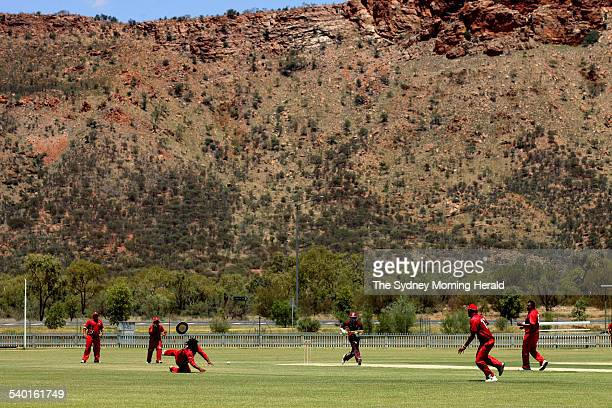 Indigenous teams from South Australia Play Queensland beneath the MacDonnell Ranges in Alice Springs for the Imparja Cup 15 February 2007 SMH Picture...