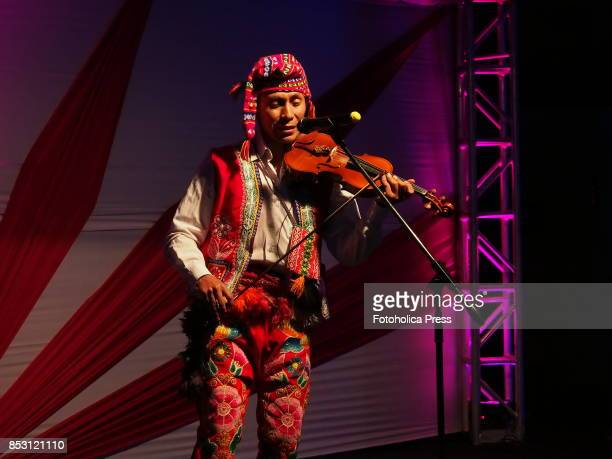 Indigenous violinist with native costume playing at the launching of Tourism Month 2017 in Cusco organized by the Regional Direction of Foreign Trade...