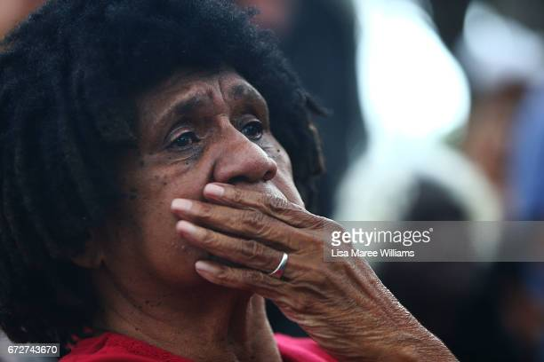 A indigenous woman looks on during the ANZAC service at Redfern Park on April 25 2017 in Sydney Australia The annual ANZAC coloured diggers event and...