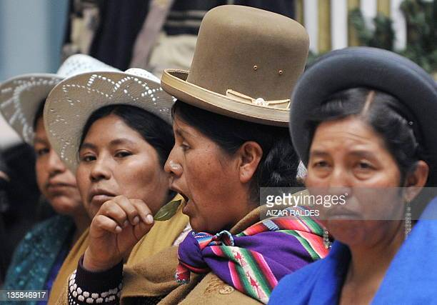 Indigenous women chew coca leaves during an indigenous coca leaf ceremony in honor of the President of the International Narcotics Control Board...