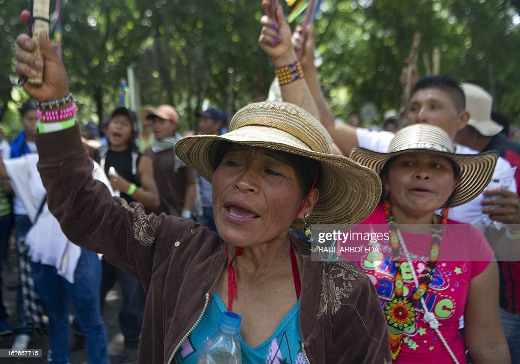 Indigenous women protest for the difficulties of the coffee sector in Bolombolo municipality, southwest of Medellin, Antioquia department, Colombia on February 25, 2013. Prices and production of coffee have dropped in the last years, informed coffee grower leaders. AFP PHOTO/Raul ARBOLEDA