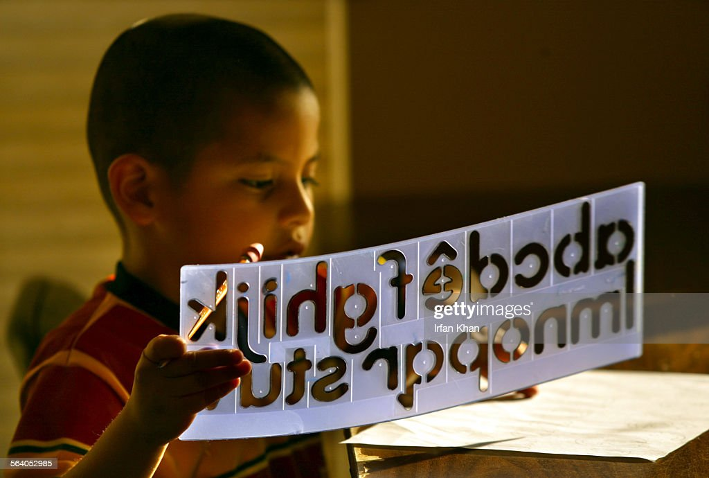 Indio, Jan.27, 2005. – – Jorge Salazar (Cq), 5, works on his alphabet during after school program at Martha's Village and Kitchen, a shelter for needy in Indio.