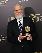 Individual Award Recipient comedian/television host David Letterman poses for photographs in the press room during the 75th Annual Peabody Awards...