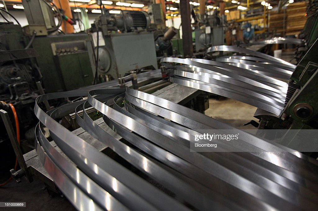 Individual steel lengths for manufacturing band saw blades await tooth milling at the DoALL Company's Contour Saws Inc. facility in Des Plaines, Illinois, U.S., on Tuesday, Aug. 28, 2012. The U.S. Census Bureau is scheduled to release factory orders data on Aug. 31. Photographer: Tim Boyle/Bloomberg via Getty Images