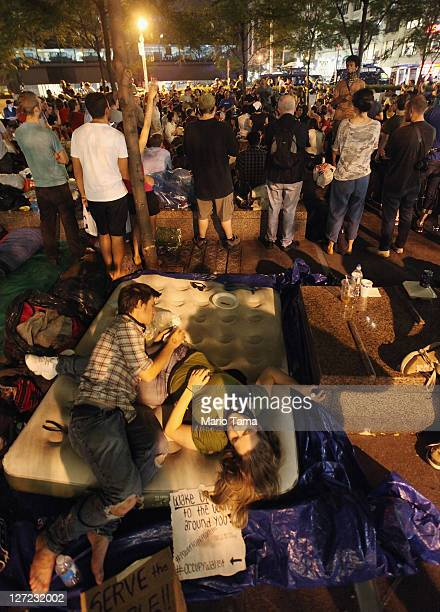 Individuals affiliated with the 'Occupy Wall Street' protest gather in a park in the Financial District near Wall Street on September 26 2011 in New...