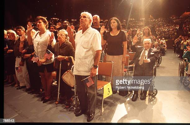 Individuals swear in to become US citizens September 25 1999 in Miami FL Three thousand people attended the swearing in ceremony and took the Oath of...