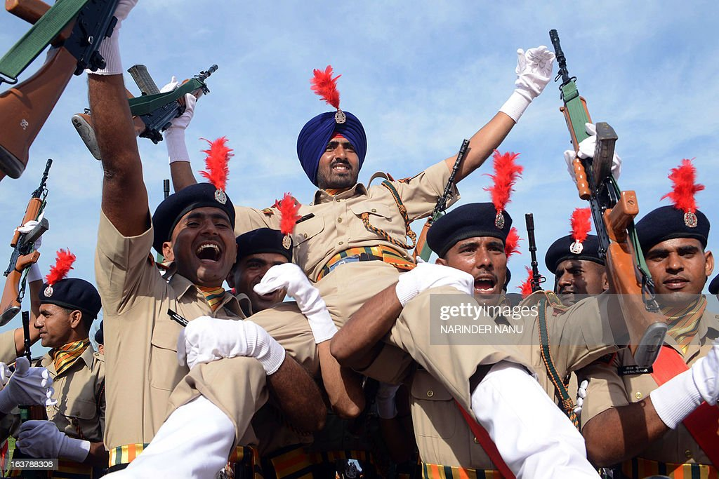 Indo -Tibetan Border Police Force (ITBPF) recruits dance after participating in a passing out parade at a signal training school on the outskirts of Amritsar on March 16, 2013. Finance Minister P. Chidambaram raised defence spending to 2.03 trillion rupees ( USD 37.45 billion) for the fiscal year starting April 1, up 5.2 percent from 2012-13 when the budget stood at 1.93 trillion rupees.