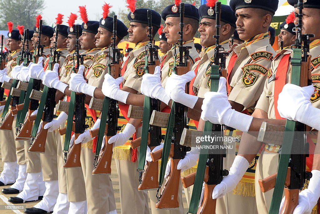 Indo -Tibetan Border Police Force (ITBPF) recruits participate in a passing out parade at a signal training school on the outskirts of Amritsar on March 16, 2013. Finance Minister P. Chidambaram raised defence spending to 2.03 trillion rupees ( USD 37.45 billion) for the fiscal year starting April 1, up 5.2 percent from 2012-13 when the budget stood at 1.93 trillion rupees.