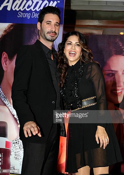 IndoCanadian actress Sunny Leone and husband Daniel Weber pose during the grand finale of the AdictionDeo Contest in Mumbai on December 20 2014 AFP...