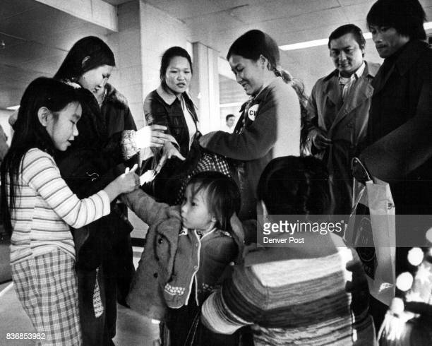 Indochina Refugees Family Help Put on Winter Coats on Newcomers Credit Denver Post