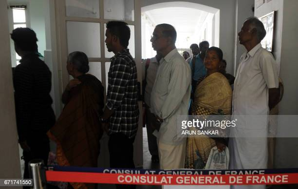 IndoFrench citizens stand in line at a polling station in Puducherry on April 23 prior to casting their votes during the first round of French...