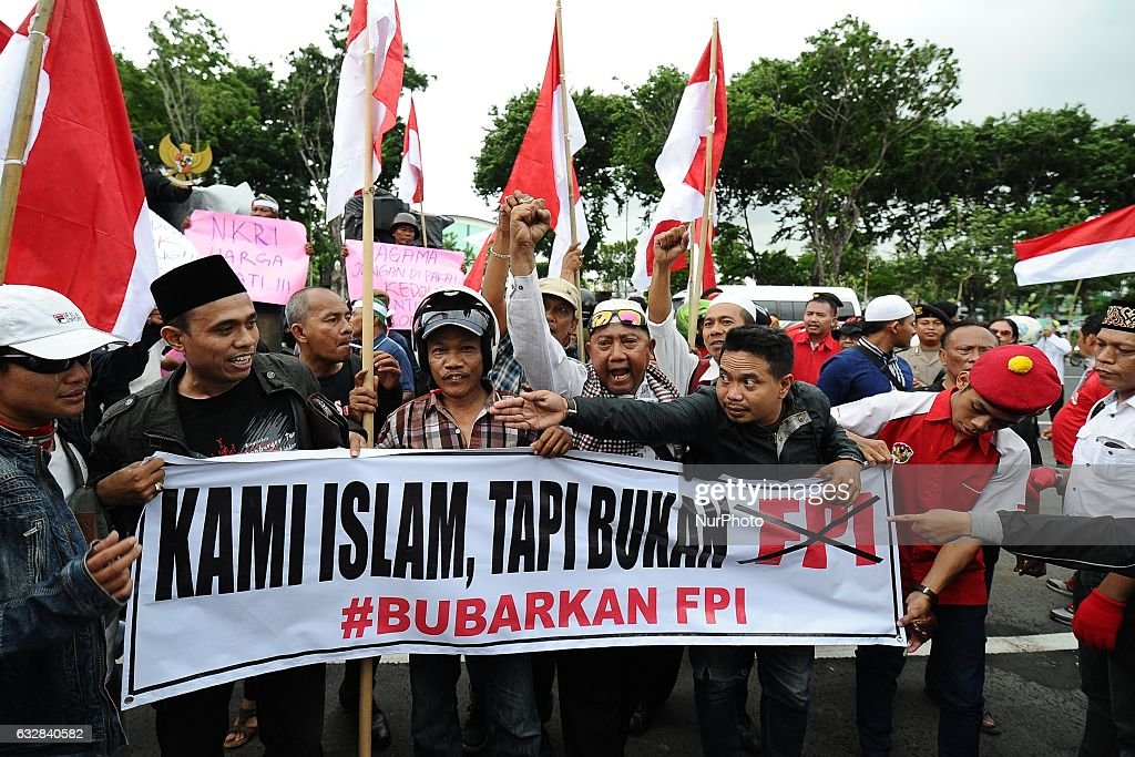 Indonesia alliance harmony and diversity members held a march asking the Indonesia police and military to crack down and dismiss the radical mass organizations like FPI (Front Pembela islam) that threaten the integrity of Indonesia in front of the East Java Regional Police office on January 26, 2017 in Surabaya, Indonesia.