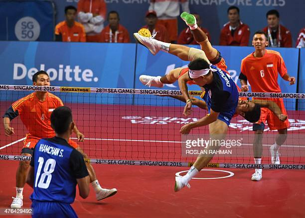 Indonesia and Thailand compete during the men's team sepak takraw match at the 28th Southeast Asian Games in Singapore on June 9 2015 AFP PHOTO /...