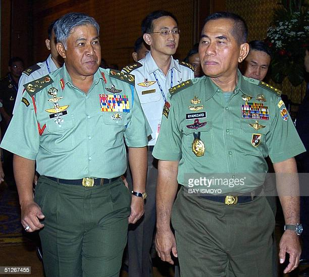 Indonesia army chief Gen Ryamizard Ryacudu walks with his Malaysian counterpart Gen Mohd Azumi after the opening ceremony of ASEAN chiefs of army...