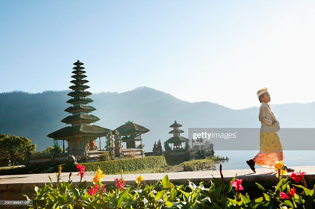 Indonesia, Bali, boy (6-8) walking near temple, side view : Stock Photo