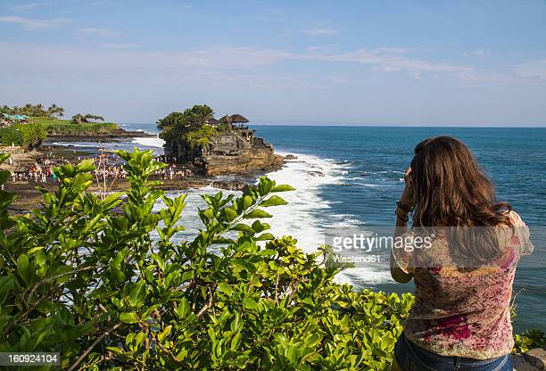 Indonesia, Bali, Tourist at Tanah Lot Temple