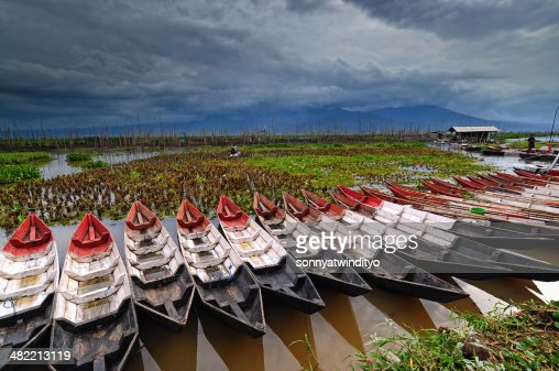 Indonesia, Central Java, Semarang, Wooden kayaks in row