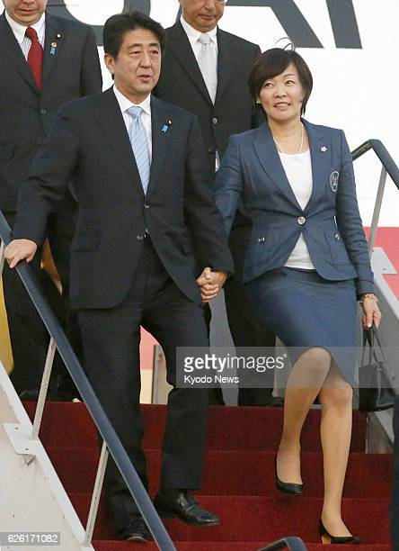 DENPASAR Indonesia Japanese Prime Minister Shinzo Abe and his wife Akie arrive at Denpasar Bali Island Indonesia on Oct 6 2013 On Bali Abe is...