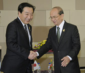 DUA Indonesia Japanese Prime Minister Yoshihiko Noda and Myanmar President Thein Sein shake hands as they met on the sidelines of regional summits in...