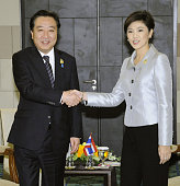 DUA Indonesia Japanese Prime Minister Yoshihiko Noda and Thai Prime Minister Yingluck Shinawatra shake hands before their meeting on the sidelines of...