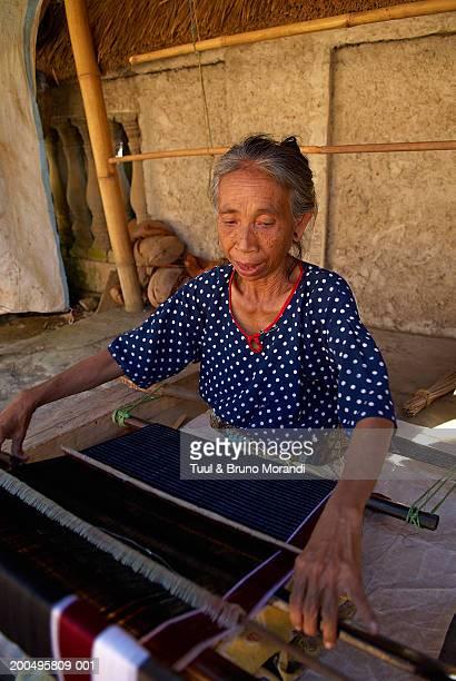 Indonesia, Lombok, Sasak, Sade, woman weaving Ikat