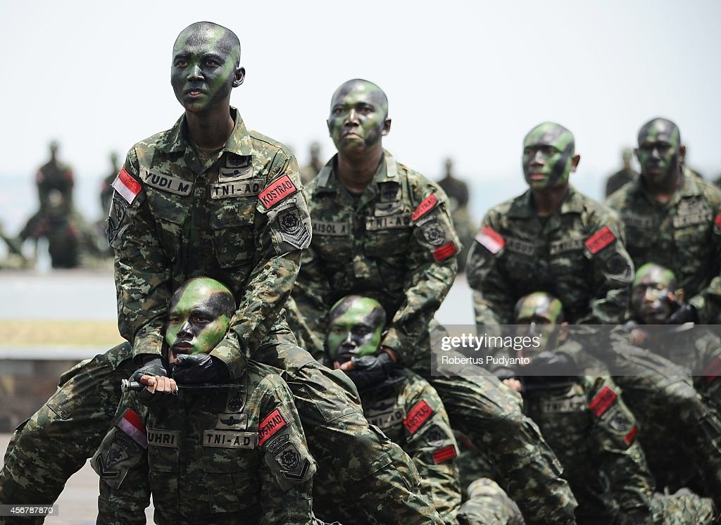 Indonesia Military members perform military martial arts during The 69th Republic of Indonesia Military Anniversary on October 7 2014 in Surabaya...